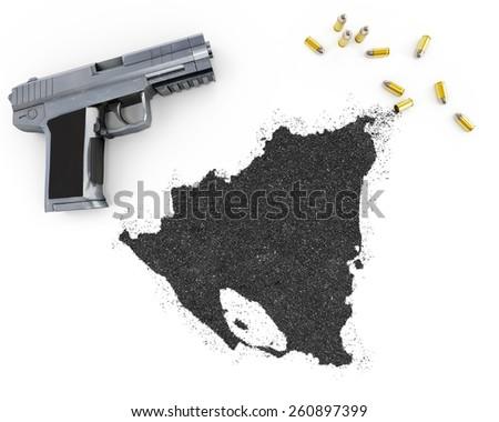 Gunpowder forming the shape of Nicaragua and a handgun.(series) - stock photo