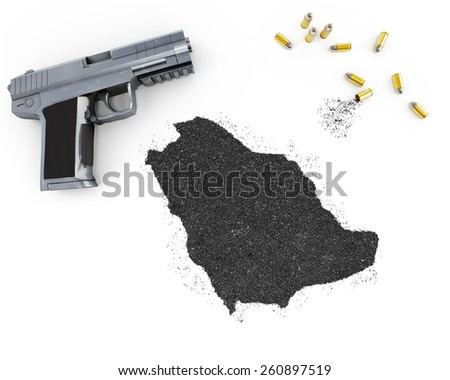 Gunpowder forming the shape of Saudi Arabia and a handgun.(series) - stock photo