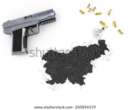 Gunpowder forming the shape of Slovenia and a handgun.(series) - stock photo