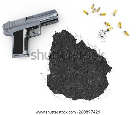 Gunpowder forming the shape of Uruguay and a handgun.(series) - stock photo