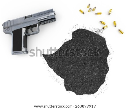 Gunpowder forming the shape of Zimbabwe and a handgun.(series) - stock photo