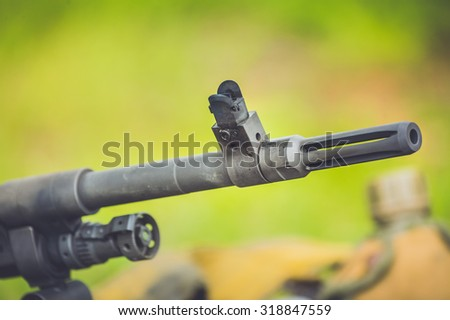 Guns , ammunition, weapons , military training smoke gun battle in a meadow in the forest landscape , military rifles , green backdrop . (AARM 2015)