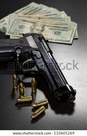 Guns and money - stock photo