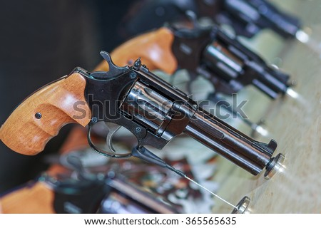 Guns on the counter. Firearms and security - stock photo