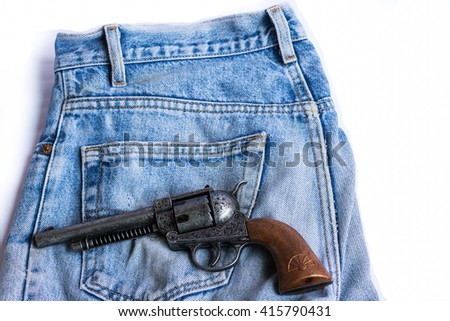 Guns, rollers Put on the jeans on a white background. - stock photo