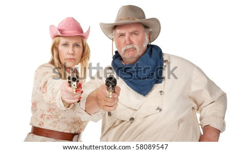 Gunslingers western wear pointing pistols and laughing - stock photo