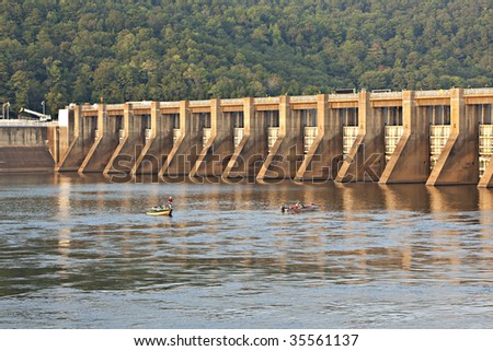 Guntersville Dam on the Tennessee River showing boats and fishermen in the water. - stock photo