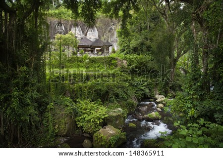 Gunung Kawi is an 11th-century temple complex in Tampaksiring north east of Ubud in Bali. It is located on the river Pakrisan.The complex comprises 10 rock-cut shrines carved into the cliff face.  - stock photo