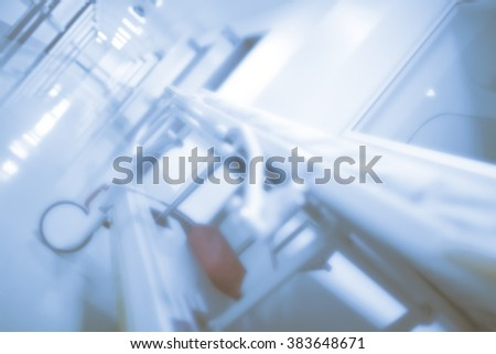 Gurney in hospital hall, defocused background. Concept of anxiety while waiting for medical conclusion. - stock photo