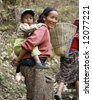 gurung lady carrying son on her back, annapurna, nepal - stock photo