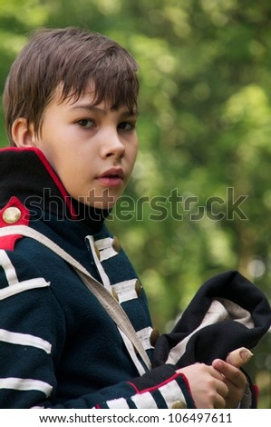 GURYEVSK, KALININGRADSKAYA OBLAST, RUSSIA - JUNE 30: kid arilleryman on celebration of 750 anniversary of Guryevsk (Neuhausen O.P.) on June 30, 2012 in Guryevsk, Kaliningradskaya oblast, Russia