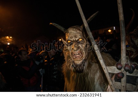 GUSSWERK, AUSTRIA - NOVEMBER 30, 2013 - Traditional Devil run (Krampuslauf) during the Christmas time. - stock photo