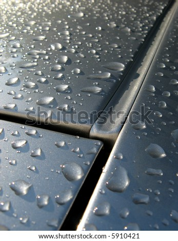 gutterpipe on car roof with rain drops - stock photo