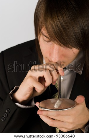 Guy about to snort a line of cocaine - stock photo