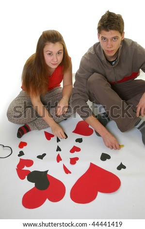 Guy and Girl in Love Holding A Heart - stock photo