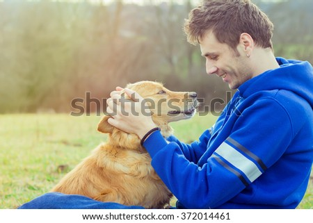 guy and his dog, golden retriever, nature - stock photo