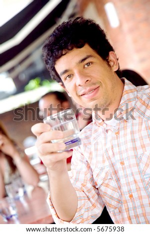 guy at a cafee having a drink looking very happy - stock photo