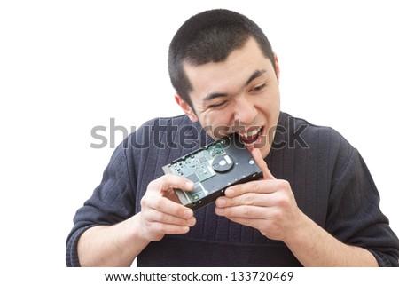 Guy bites hard drive - stock photo