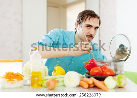 guy doing vegetarian lunch at kitchen - stock photo