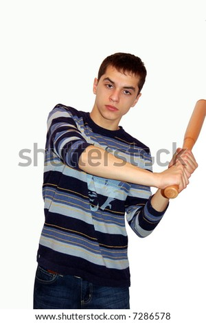 guy dressed in blue jeans holds a bat in his hands - stock photo