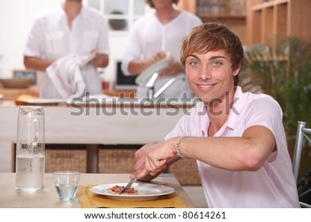 Guy eating - stock photo
