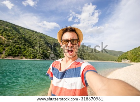 Guy gets a selfie during his vacation at sea - people, holiday, nature and lifestyle concept - stock photo