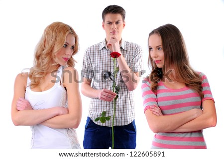 guy gives flowers to two girls - stock photo