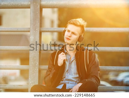 guy hipster listens player on the street  - stock photo