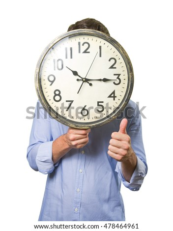 Guy holding a big clock with a gesture of approval on white background