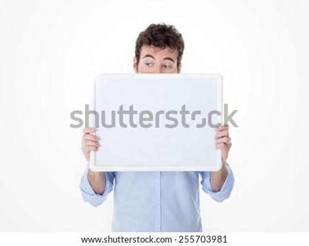 guy holding a white banner and hiding his face behind it - stock photo