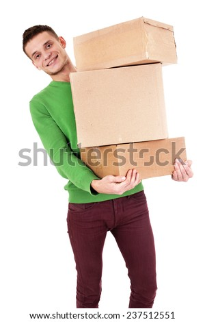 Guy holding large cardboard boxes. Vertical shot. Isolated on white.