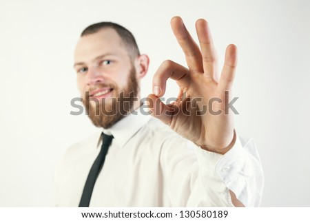 guy in a suit shows OK - stock photo