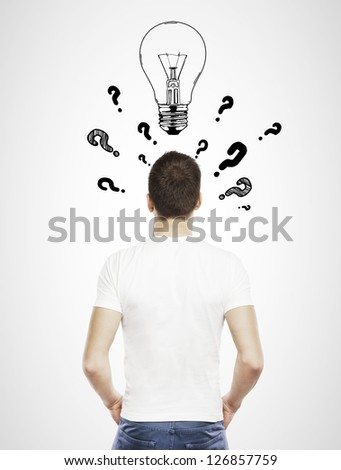 guy in T-shirt with question mark and lamp - stock photo