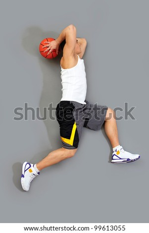 Guy jumping to score a goal playing basketball - stock photo