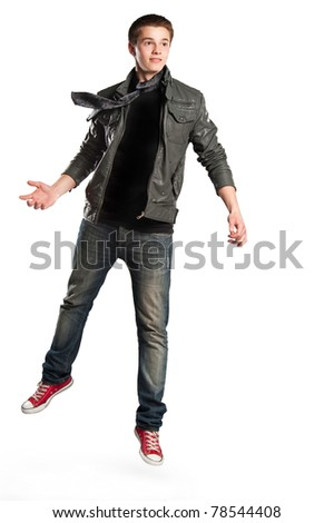 guy jumps on the isolated background - stock photo