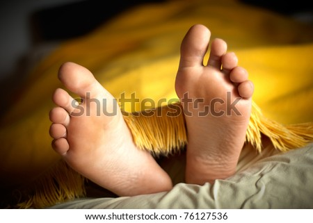 guy lie in a yellow bed - stock photo