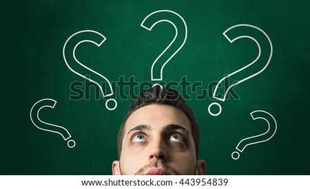Guy Looking Ahead in a Chalkboard with a Question Mark