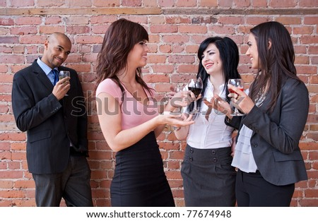 Guy looking at girls drinking wine and having fun. - stock photo