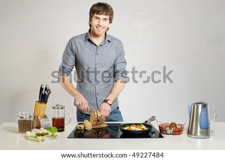 Guy on kitchen - stock photo