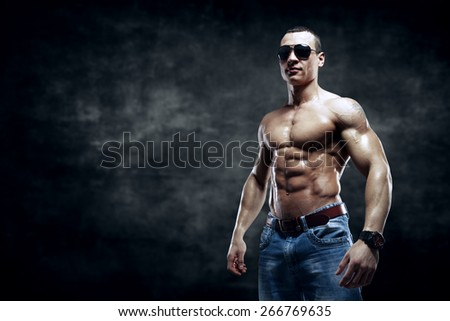 guy on the dark background with sunglasses isolated  - stock photo