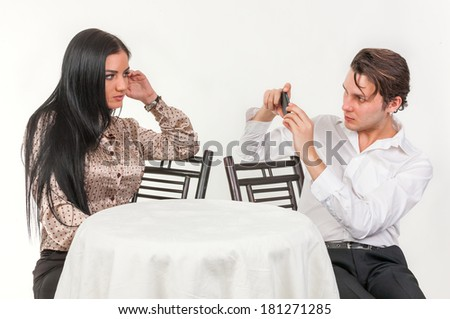 Guy photographed girl in a cafe