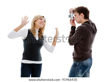 Guy photographed girl retro camera, isolated on a white background.