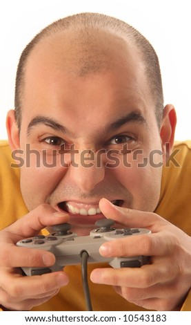 guy playing video game console controller - stock photo