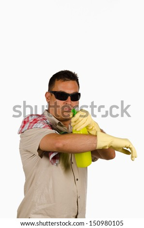 Guy pointing at the camera with a bottle of cleaning product - stock photo