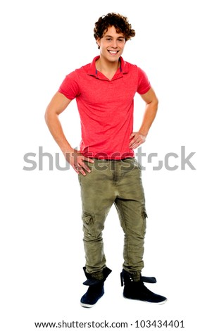 Guy posing with hands on his waist, smiling at camera - stock photo