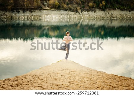 guy practices asanas on yoga in harmony with the nature - stock photo