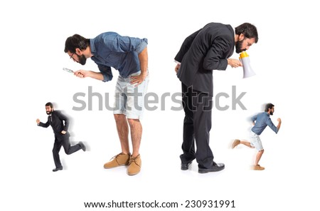 guy scaring his brother over white background - stock photo