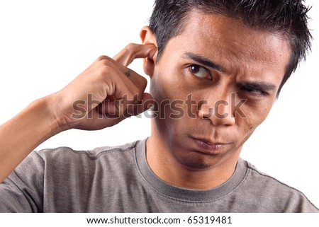 Guy Scratching an Itch in His Ear - stock photo