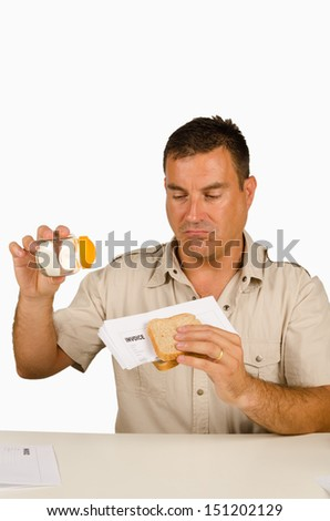 Guy setting up a sandwich stuffed with bills, a financial concept