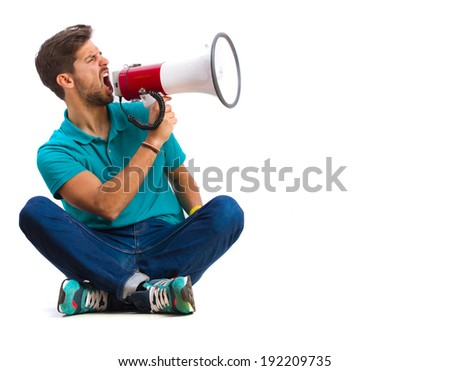 guy shouting by megaphone - stock photo